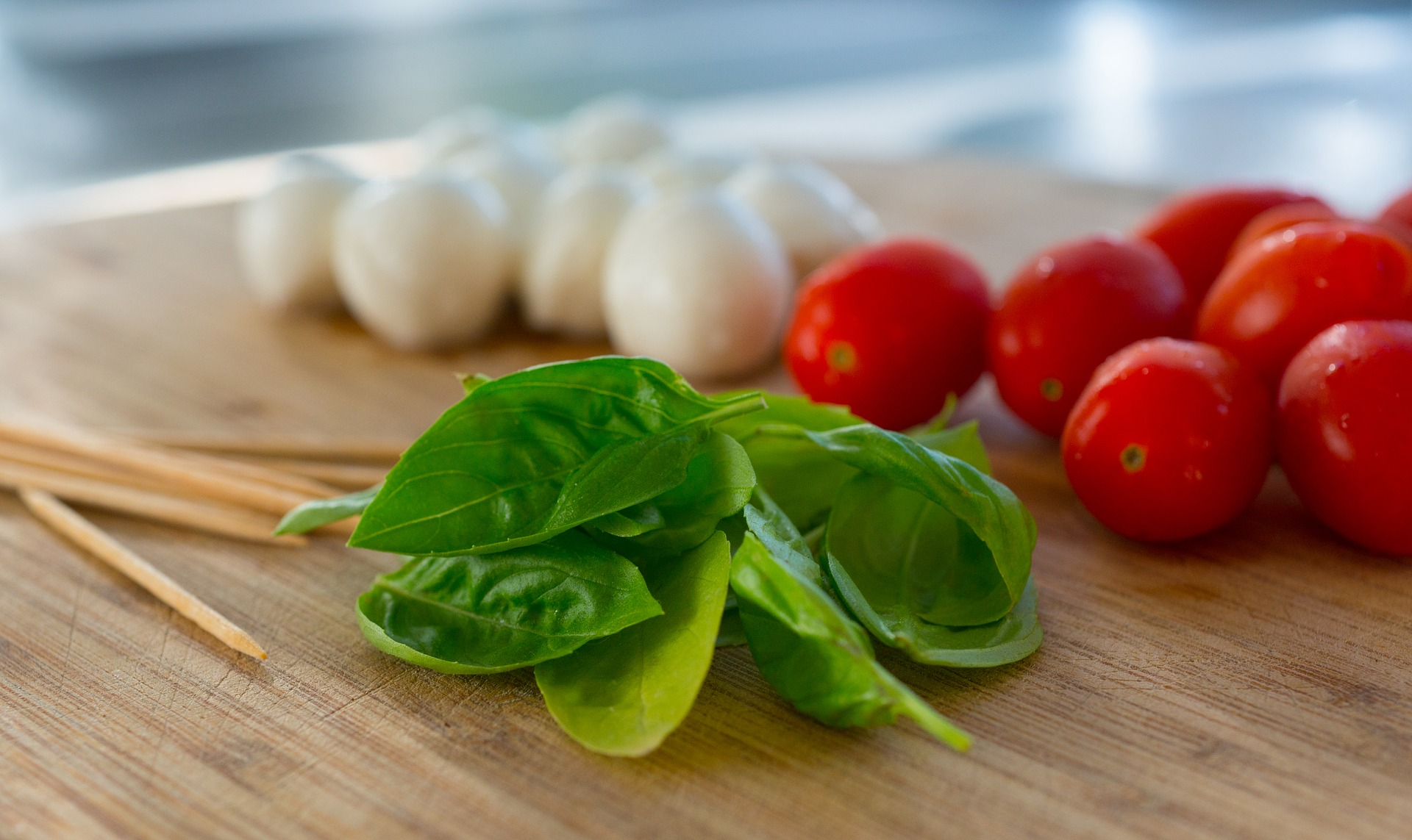 Caprese ingredients: mozzarella, tomato, and basil